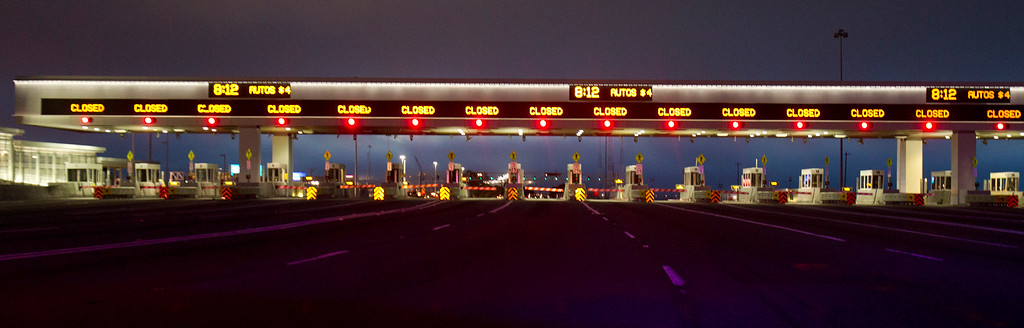 . All lanes of the toll plaza sport a red light and a closed sign as officials shut down the Bay Bridge so that finishing construction of the new eastern span of the bridge could begin on Wednesday, Aug. 28, 2013, in Oakland, Calif. (D. Ross Cameron/Bay Area News Group)