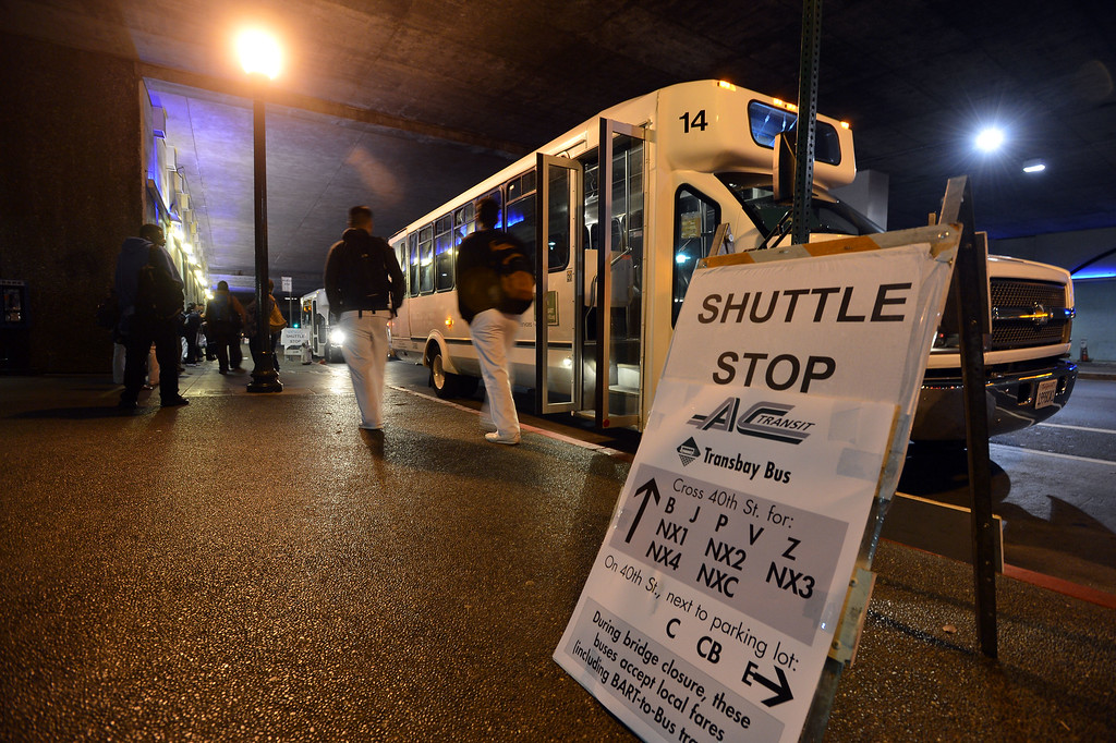 . Shuttles line up to carry commuters at the MacArthur BART station in Oakland, Calif., on Thursday, Aug. 29, 2013. (Kristopher Skinner/Bay Area News Group)