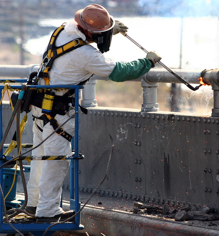 . A worker uses a cutting torch as demolition of the old Bay Bridge continues in Oakland, Calif., on Saturday, Aug. 31, 2013. According to Caltrans, progress continues to remain on schedule on the third day of the bridge closure. (Anda Chu/Bay Area News Group)