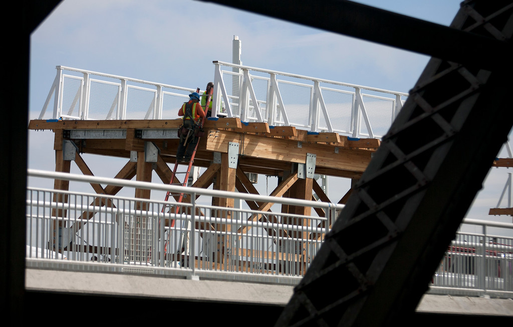 . Construction workers ready a section of bike path for placement in the new eastern span of the Bay Bridge, Sunday, Sept. 1, 2013, in Oakland, Calif., as work continued in advance of its scheduled opening on Tuesday at 5 a.m. (D. Ross Cameron/Bay Area News Group)