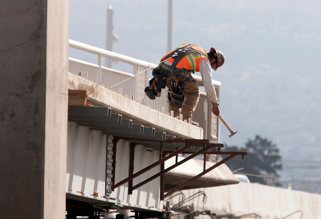 . A construction worker prepares the footings for a bike lane on the new eastern span of the Bay Bridge, Sunday, Sept. 1, 2013, in Oakland, Calif., as work continued in advance of its scheduled opening on Tuesday at 5 a.m. (D. Ross Cameron/Bay Area News Group)