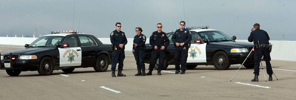 . Unidentified California Highway Patrol officers pose for a photograph on the new eastern span of the Bay Bridge, Sunday, Sept. 1, 2013, in Oakland, Calif., as work continued in preparation for its scheduled opening on Tuesday at 5 a.m. (D. Ross Cameron/Bay Area News Group)