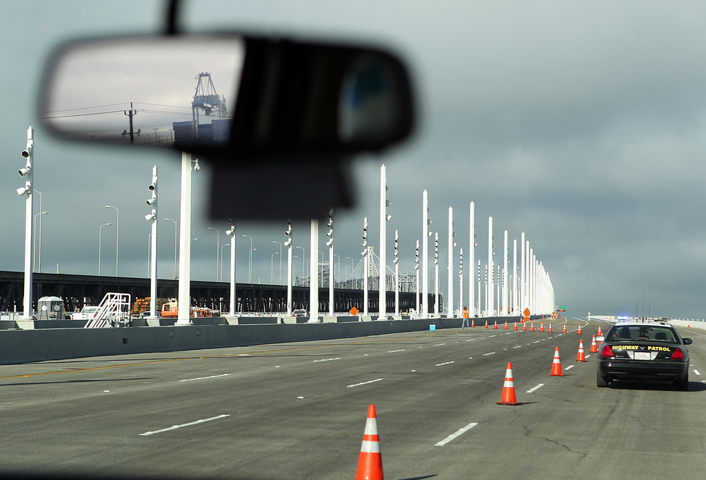 . A California Highway Patrol vehicle leads a media tour of the new Bay Bridge eastern span in San Francisco, Calif., on Saturday, Aug. 31, 2013. According to Caltrans, progress continues to remain on schedule on the third day of the bridge closure. (Anda Chu/Bay Area News Group)
