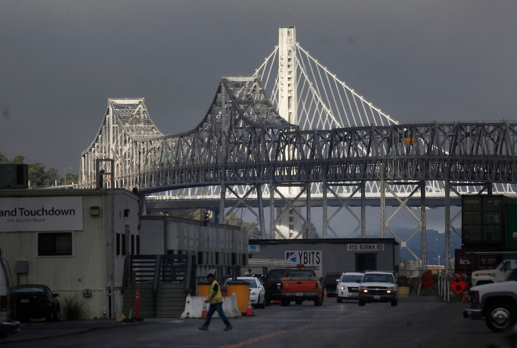 . The new Bay Bridge glows in the morning light Thursday morning, Aug. 29, 2013, the day after the old cantilever span was closed. Caltrans promises to have drivers on the new $6.4 billion span by Tuesday morning. (Karl Mondon/Bay Area News Group)