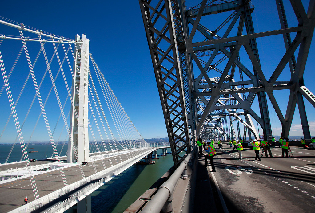 . Caltrans senior engineer Brian Maroney leads a press tour onto the old cantilever section of the Bay Bridge while discussing how the $239 million demolition project will proceed, Thursday, Aug. 29, 2013, in San Francisco, Calif.  (Karl Mondon/Bay Area News Group)