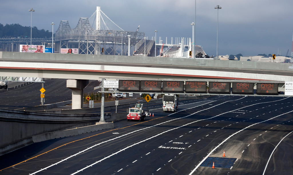 . The newly repaved toll plaza sits ready for traffic to the new eastern span of the Bay Bridge, Sunday, Sept. 1, 2013, in Oakland, Calif., as work continued to prepare the new span for its scheduled opening on Tuesday at 5 a.m. (D. Ross Cameron/Bay Area News Group)