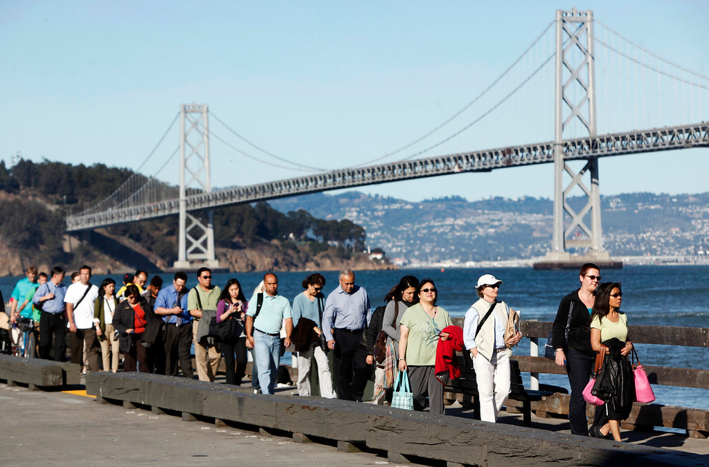 . With the closed Bay Bridge serving as a backdrop, afternoon commuters wait for the Harbor Bay Ferry on Thursday, Aug. 29, 2013, in San Francisco, Calif. (Karl Mondon/Bay Area News Group)