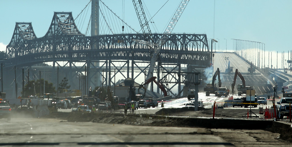 . Demolition of the old eastern span of the Bay Bridge is underway near the toll plaza in Oakland, Calif., on Thursday, Aug. 30, 2013.  The new eastern span is scheduled to open on Tuesday, September 3, at 5 a.m. (Ray Chavez/Bay Area News Group)