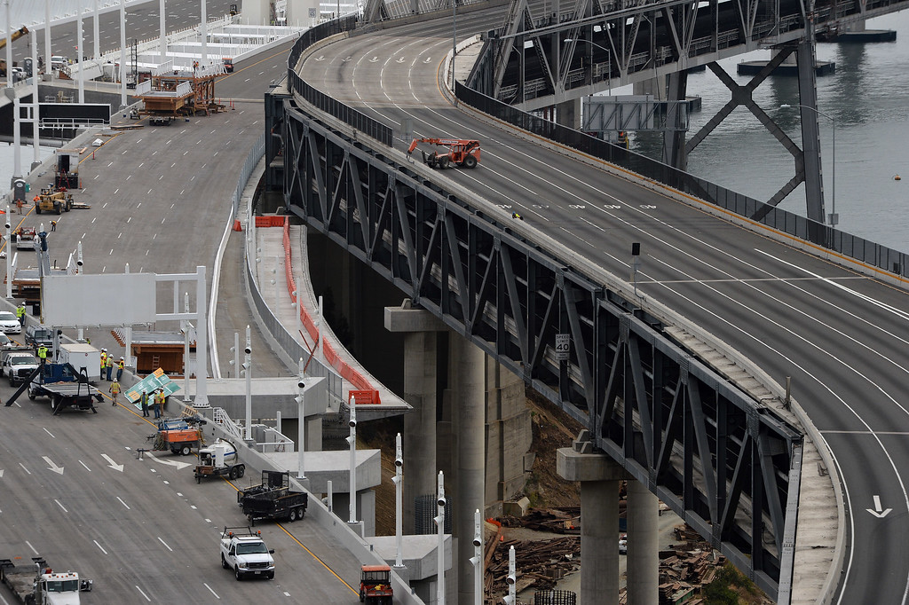 . Paving work is done on the Yerba Buena Island approach to the Bay Bridge in Oakland, Calif. on Thursday, Aug. 29, 2013. (Kristopher Skinner/Bay Area News Group)