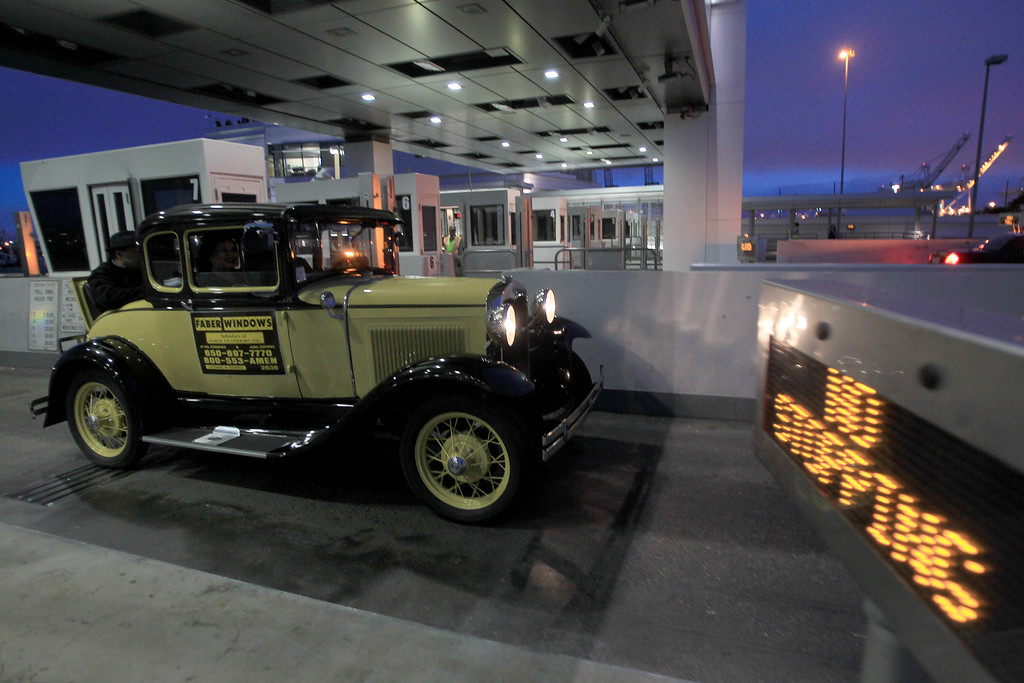 . Bob Faber, of Richmond, drives his 1930 Model A Ford through the toll plaza as it became the last car ever to cross the the old eastern span of the Bay Bridge in Oakland, Calif., on Wednesday, Aug. 28, 2013. The old span was shut down permanently at 8 p.m. tonight, and the new span is scheduled to open to traffic at 5 a.m. on Tuesday, Sept. 3.  Construction of the largest self-anchored suspension bridge in the world began in 2002. (Jane Tyska/Bay Area News Group)