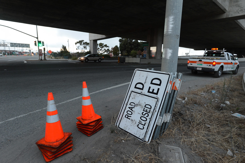 . Workers begin to close the West Grand Avenue onramp to Interstate 80 and the Bay Bridge in Oakland, Calif., on Wednesday, Aug. 28, 2013. The bridge is scheduled to reopen on Tuesday, Sept. 3. (Susan Tripp Pollard/Bay Area News Group)