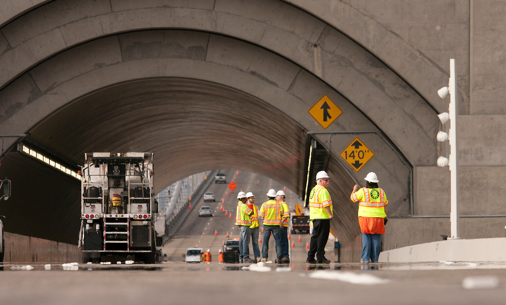 . Construction workers clean up the Yerba Buena Island tunnel at the west end of the new eastern span of the Bay Bridge, Sunday, Sept. 1, 2013, in Oakland, Calif., as work continued in advance of its scheduled opening on Tuesday at 5 a.m. (D. Ross Cameron/Bay Area News Group)