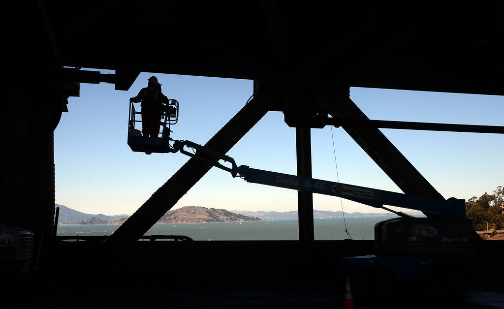 . With the five-day bridge closure in place, maintenance crews work Friday morning, Aug. 30, 2013 on the lower deck of the original Bay Bridge\'s western span in San Francisco, Calif. (Karl Mondon/Bay Area News Group)