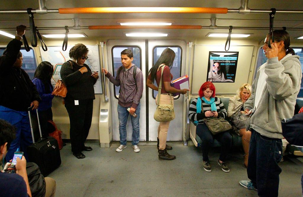 . Passengers board a San Francisco bound train at the Hayward BART station on Thursday, Aug. 29, 2013, in Hayward, Calif.  (Aric Crabb/Bay Area News Group)