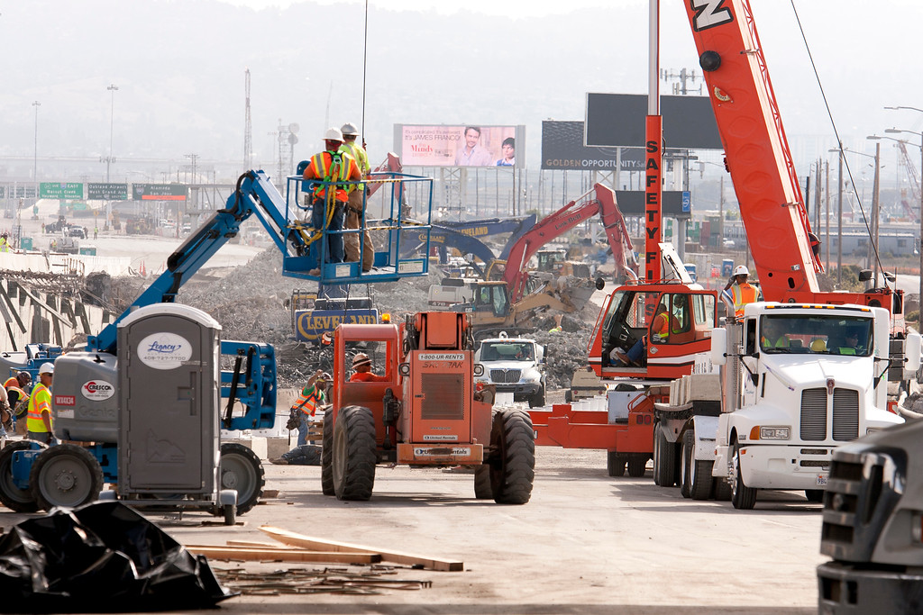 . Demolition crews tear down the old eastern span of the Bay Bridge, Sunday, Sept. 1, 2013, in Oakland, Calif., in advance of the scheduled opening of the new span on Tuesday at 5 a.m. (D. Ross Cameron/Bay Area News Group)