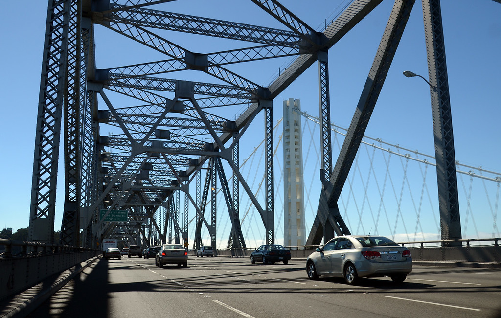 . Vehicles cross under the 76-year-old Bay Bridge\'s cantilever section five hours before it is decommissioned later Wednesday evening, Aug. 28, 2013, between Oakland and San Francisco, Calif. (Karl Mondon/Bay Area News Group)