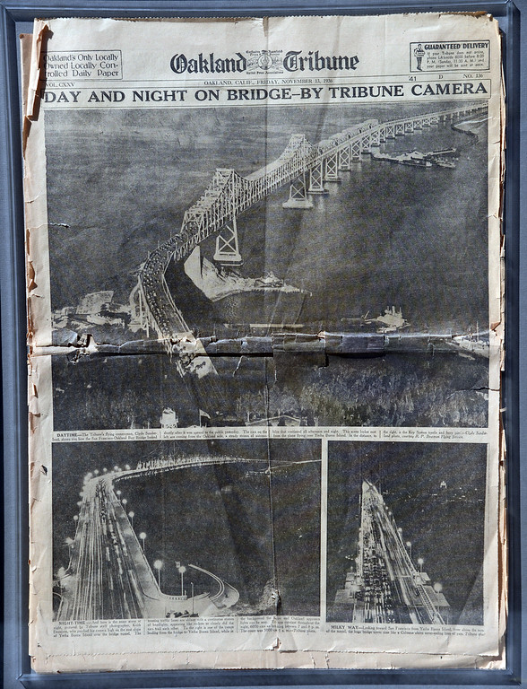 . A 76-year-old copy of the Oakland Tribune celebrates the opening of the original Bay Bridge on Nov. 12, 1936, with Clyde Sunderman aerial photographs showing the first vehicles to cross the brand new span near Yerba Buena Island. (Bay Area News Group Archives)