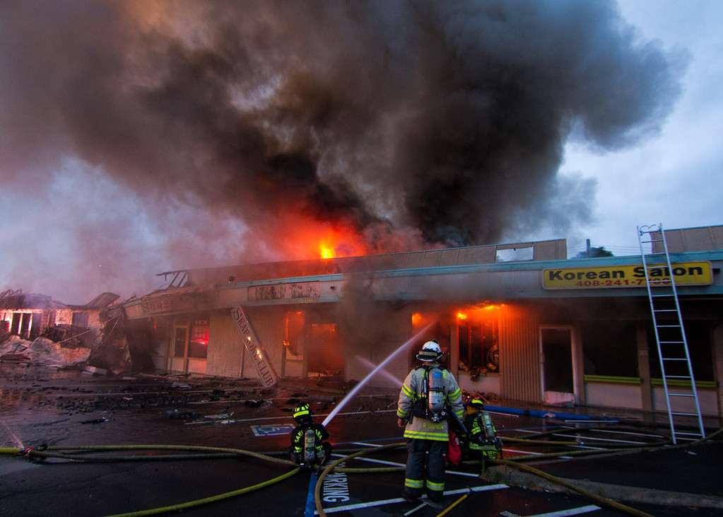 . Courtesy Craig Allyn Rose � Firefighters from the Santa Clara and Sunnyvale fire departments battle a five-alarm fire which destroyed many businesses in the Rancho Shopping Center strip mall on the El Camino Real shortly after 2 a.m. Wednesday, May 25, 2016.
