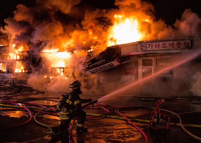 Courtesy Craig Allyn Rose — Firefighters from the Santa Clara and Sunnyvale fire departments battle a five-alarm fire which destroyed many businesses in the Rancho Shopping Center strip mall on the El Camino Real shortly after 2 a.m. Wednesday, May 25, 2016.