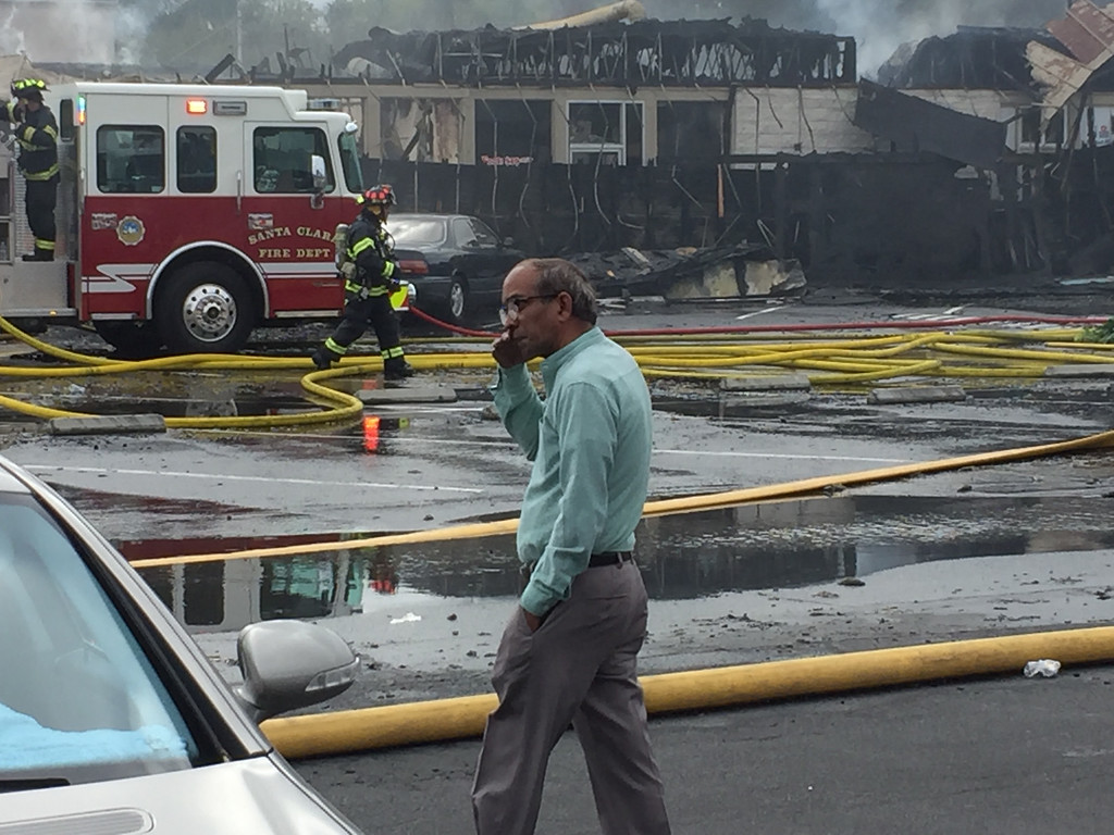 . Prakash Patel\'s Indian vegetarian restaurant Radha Chaat, went up in flames along with other businesses in a strip mall on El Camino Real in Santa Clara on May 24, 2016. He has been doing business in the mall for about four years. (Mark Gomez/Bay Area News Group.