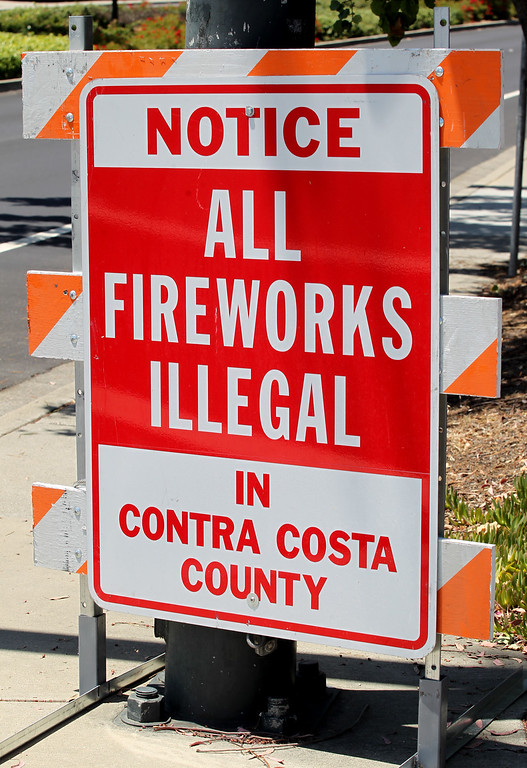 . A sign informs the public that all fireworks are illegal in Contra Costa County along Bollinger Canyon Road in San Ramon, Calif., on Thursday June 30, 2016.  (Anda Chu/Bay Area News Group)