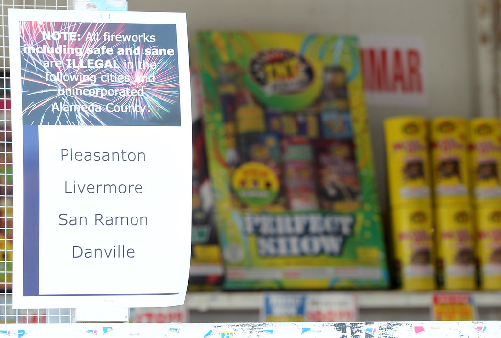 . A sign informs customers that all fireworks are illegal in surrounding cities at a fireworks stand along Dublin Boulevard in Dublin, Calif., on Thursday, June 30, 2016.  (Anda Chu/Bay Area News Group)