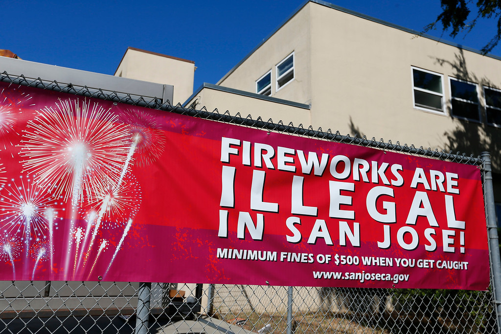 . A banner warning the public of the penalties of using illegal fireworks hangs at Station 3 of the San Jose Fire Department on Martha St. in San Jose, Calif., on Thursday, June 30, 2016. San Jose officials earlier announced stiffer penalties for using illegal fireworks including a $500 fine for the first offense. (Gary Reyes/Bay Area News Group)