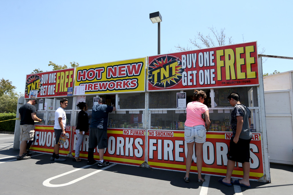 """. Customers shop for \""""safe and sane\"""" fireworks at a stand along Dublin Boulevard in Dublin, Calif., on Thursday, June 30, 2016.  (Anda Chu/Bay Area News Group)"""