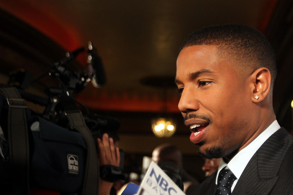 ". Michael B. Jordan who plays the role of Oscar Grant in the film ""Fruitvale Station,\"" speaks to the media on a red carpet during a private screening of the award winning film at the Grand Lake Theater in Oakland, Calif., on Thursday, June 20, 2013.  The film chronicles the last hours of Oscar Grant\'s life before he was shot and killed on New Year\'s Eve 2009. (Ray Chavez/Bay Area News Group)"