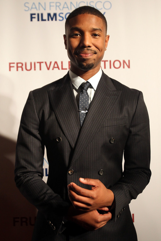 ". Michael B. Jordan who plays the role as Oscar Grant in the film ""Fruitvale Station,\"" speaks to the media on a red carpet during a private screening of the award winning film at the Grand Lake Theater in Oakland, Calif., on Thursday, June 20, 2013.  The film chronicles the last hours of Oscar Grant\'s life before he was shot and killed on New Year\'s Eve 2009. (Ray Chavez/Bay Area News Group)"
