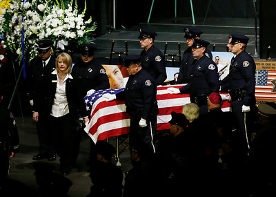 The casket for Michael Johnson, San Jose Police Department Officer, is escorted out of of the SAP Center following his memorial service in San Jose, Calif., on Thursday, April 2, 2015. (Gary Reyes/Bay Area News Group)