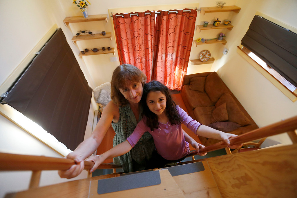". Karen Chapple, left, and her daughter Lexi Chapple, 9, are photographed in Chapple\'s accessory dwelling unit in the backyard of her home in Berkeley, Calif., on Tuesday, July 12, 2016. Chapple is a UC Berkeley professor and affordable housing expert, and had the tiny 400-square-foot ""granny\"" unit built five years ago. (Jane Tyska/Bay Area News Group)"