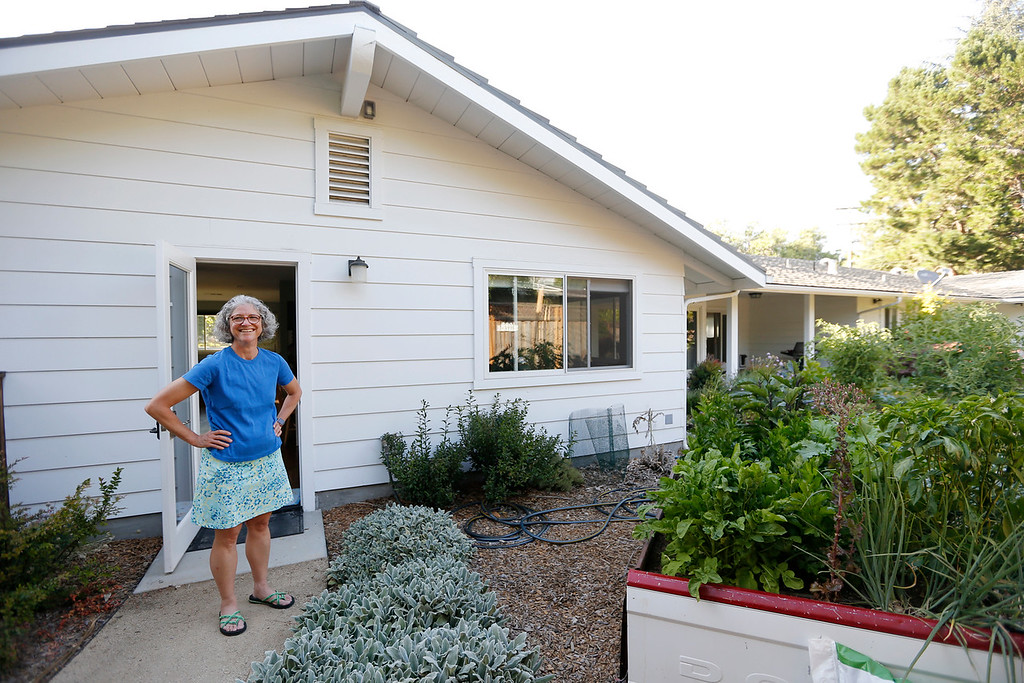 . Erin Craig is photographed in front of the studio the family built for her daughter, Kim Dvorak,  in Menlo Park, Calif., on Thursday, June 30, 2016.  The unit is a 640-square-foot studio apartment in a converted garage. (Josie Lepe/Bay Area News Group)