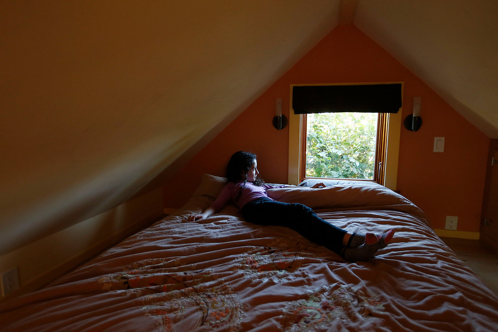". Karen Chapple\'s daughter Lexi Chapple, 9, is photographed in the loft of Chapple\'s accessory dwelling unit in the backyard of her home in Berkeley, Calif., on Tuesday, July 12, 2016. Chapple is a UC Berkeley professor and affordable housing expert, and had the tiny 400-square-foot ""granny\"" unit built five years ago. (Jane Tyska/Bay Area News Group)"