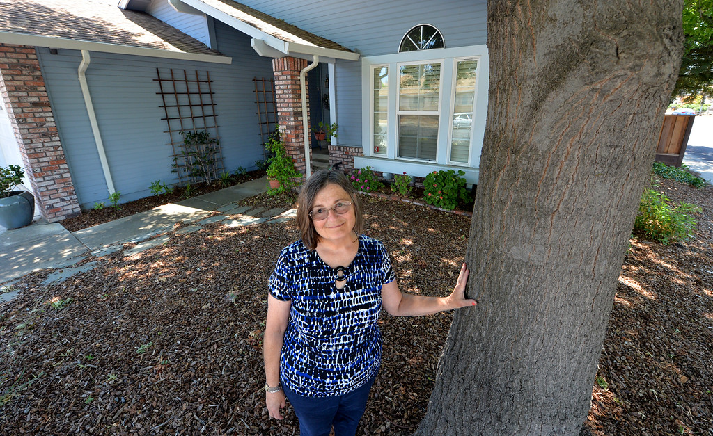 . Elizabeth Copley, of Concord, is photographed standing in front of her home in Concord, Calif., on Friday, July 1, 2016. Copley would like to convert one of the three bedrooms in her home into a 250-square foot studio accessory unit and rent it out to help pay her mortgage. However, she may not be able to build because of high permit fees. Currently State legislators bills to ease and encourage the building of secondary units are now making their way through the legislature. (Doug Duran/Bay Area News Group)