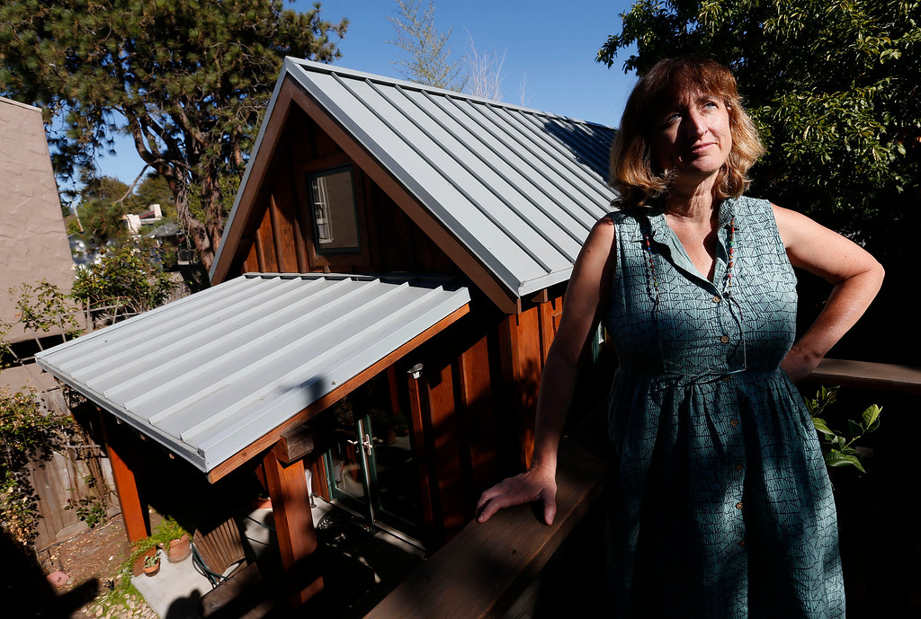 ". Karen Chapple is photographed on her deck overlooking her accessory dwelling unit at her home in Berkeley, Calif., on Tuesday, July 12, 2016. Chapple is a UC Berkeley professor and affordable housing expert, and had the tiny 400-square-foot ""granny\"" unit built five years ago. (Jane Tyska/Bay Area News Group)"