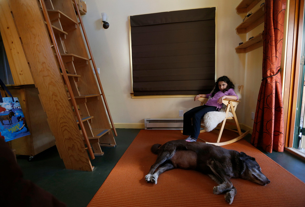 ". Karen Chapple\'s daughter Lexi Chapple, 9, hangs out with their dog Clay in Chapple\'s accessory dwelling unit in the backyard of her home in Berkeley, Calif., on Tuesday, July 12, 2016. Chapple is a UC Berkeley professor and affordable housing expert, and had the tiny 400-square-foot ""granny\"" unit built five years ago. (Jane Tyska/Bay Area News Group)"