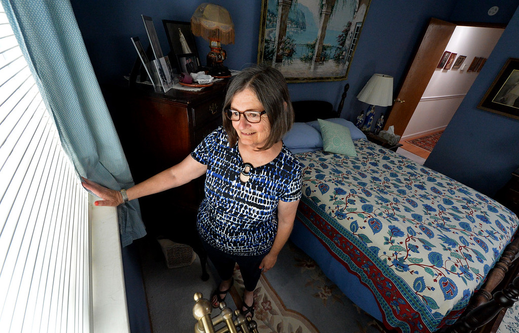 . Elizabeth Copley, of Concord, is photographed looking out the window of the room she would like to make into a studio accessory unit at her home in Concord, Calif., on Friday, July 1, 2016. Copley would like to convert one of the three bedrooms in her home into a 250-square foot studio accessory unit and rent it out to help pay her mortgage. However, she may not be able to build because of high permit fees. Currently State legislators bills to ease and encourage the building of secondary units are now making their way through the legislature. (Doug Duran/Bay Area News Group)