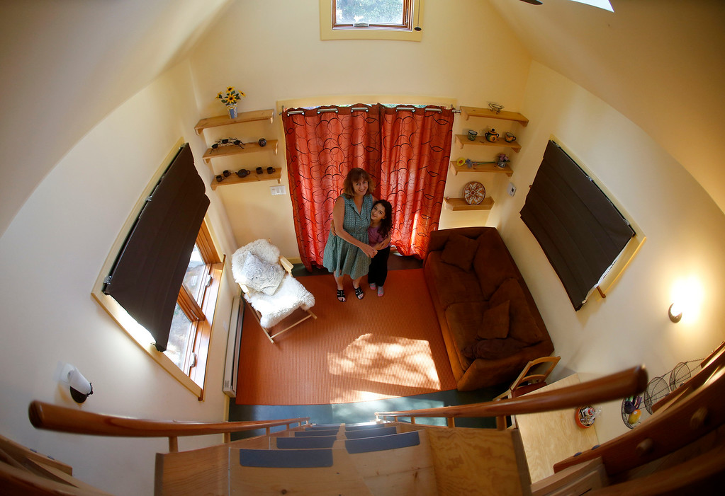 ". Karen Chapple, left, and her daughter Lexi Chapple, 9, are photographed in Chapple\'s accessory dwelling unit in the backyard of her home in Berkeley, Calif., on Tuesday, July 12, 2016. Chapple is a UC Berkeley professor and affordable housing expert, and had the tiny 400-square-foot ""granny\"" unit built five years ago. This photo was made with an extreme wide-angle lens. (Jane Tyska/Bay Area News Group)"