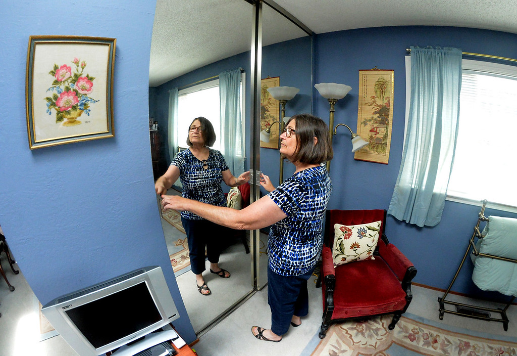 . Elizabeth Copley, of Concord, talks about the closet area that would be converted into a kitchenette in the room she would like to make into a studio accessory unit at her home in Concord, Calif., on Friday, July 1, 2016. Copley would like to convert one of the three bedrooms in her home into a 250-square foot studio accessory unit and rent it out to help pay her mortgage. However, she may not be able to build because of high permit fees. Currently State legislators bills to ease and encourage the building of secondary units are now making their way through the legislature. (Doug Duran/Bay Area News Group)