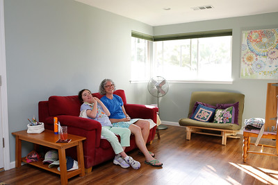 Kim Dvorak, 26, left, is photographed with her mother Erin Craig in her studio in Menlo Park, Calif., on Thursday, June 30, 2016.  The family built an accessory unit for Dvorak, a 640-square-foot studio apartment in a converted garage. (Josie Lepe/Bay Area News Group)