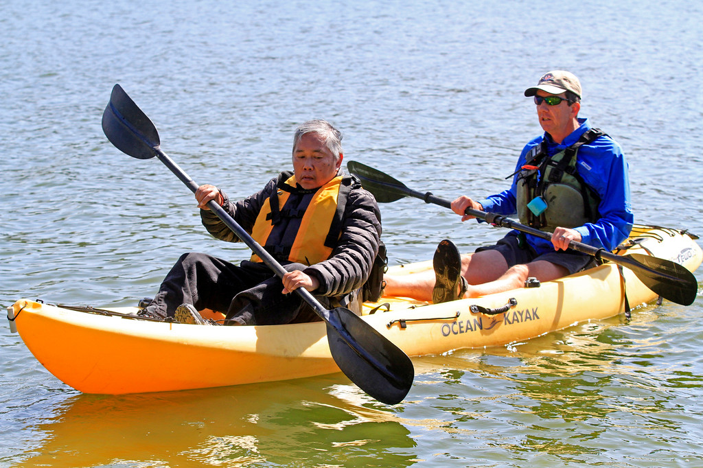 . Rob Knoles, one of the four coordinators of the Heroes on the Water program, right, takes veteran Albert Anub for a paddle in a kayak at the San Pablo Dam Reservoir Recreation Area on Friday, April 29, 2016. Anub is a Vietnam veteran who is suffering from Parkinson\'s disease.  (Laura A. Oda/Bay Area News Group)