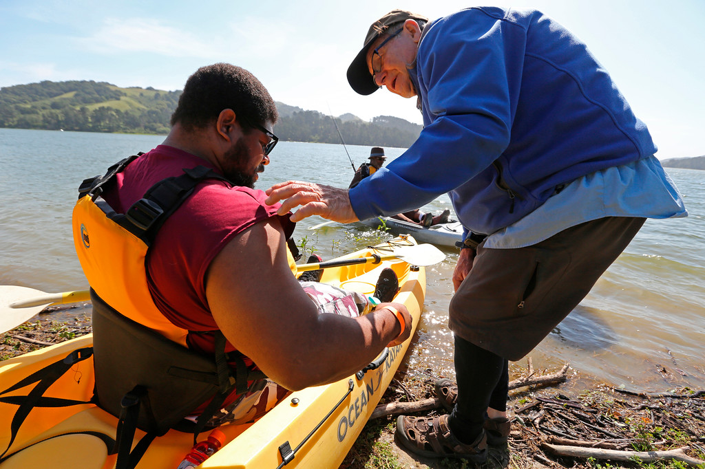 . Raydon Shippey, one of four organizers of the Heroes on the Water event gives some kayaking instruction to veteran Dwight Morgan from Stockton as he gets ready to kayak for the first time at the San Pablo Dam Reservoir Recreation Area on Friday, April 29, 2016.  Dwight is a 14-year veteran who recently lost his leg to a motorcycle accident and is in rehabilitation at the VA Palo Alto Health Care Systems. (Laura A. Oda/Bay Area News Group)