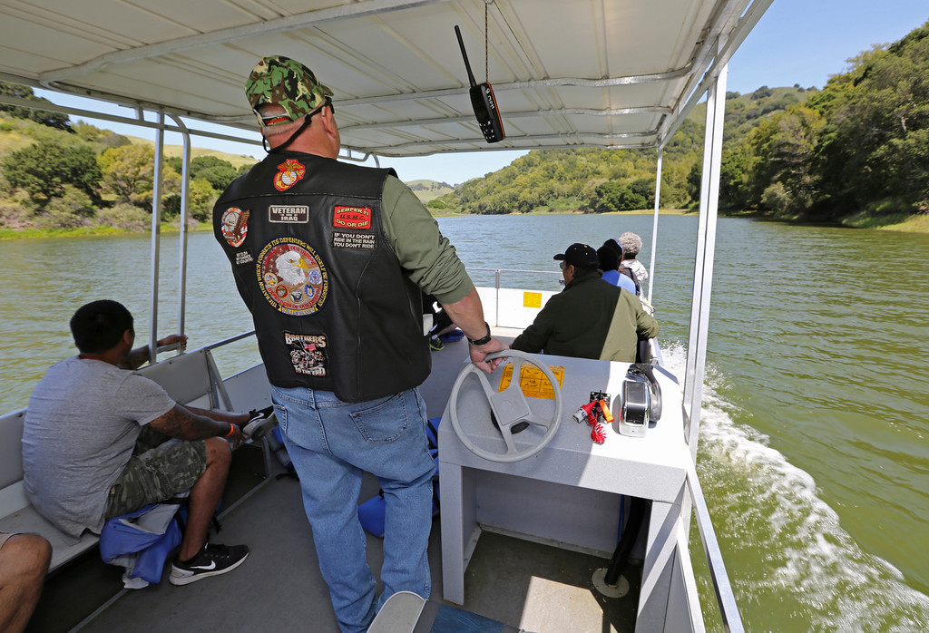 . Staff Sgt. Russ Roberts takes a group of fellow veterans on a boat ride at the San Pablo Dam Reservoir Recreation Area during the Heroes on the Water event on Friday, April 29, 2016. Heroes on the Water, founded in 2007, is a national organization which takes wounded and homeless veterans on fishing and kayaking trips, engaging them in leisure activities that have therapeutic effects. (Laura A. Oda/Bay Area News Group)