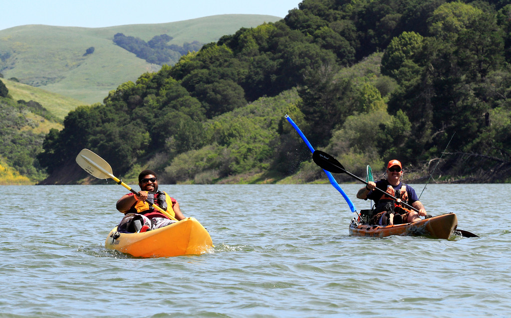 ". Fourteen-year veteran Dwight Morgan, left, paddles toward shore with volunteer William ""Sarge\"" Wirt, an active duty Sgt. in the National Guard, after a long paddle around the San Pablo Dam Reservoir Recreation Area on Friday, April 29, 2016.  Morgan recently lost his leg to a motorcycle accident and is in rehabilitation at the VA Palo Alto Health Care Systems. (Laura A. Oda/Bay Area News Group)"
