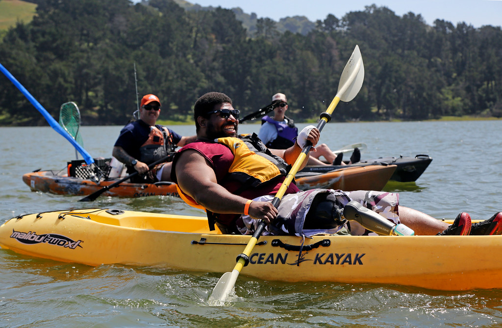 . Fourteen-year veteran Dwight Morgan paddles toward shore after a long paddle around the San Pablo Dam Reservoir Recreation Area on Friday, April 29, 2016. Morgan recently lost his leg to a motorcycle accident and is in rehabilitation at the VA Palo Alto Health Care Systems. (Laura A. Oda/Bay Area News Group)