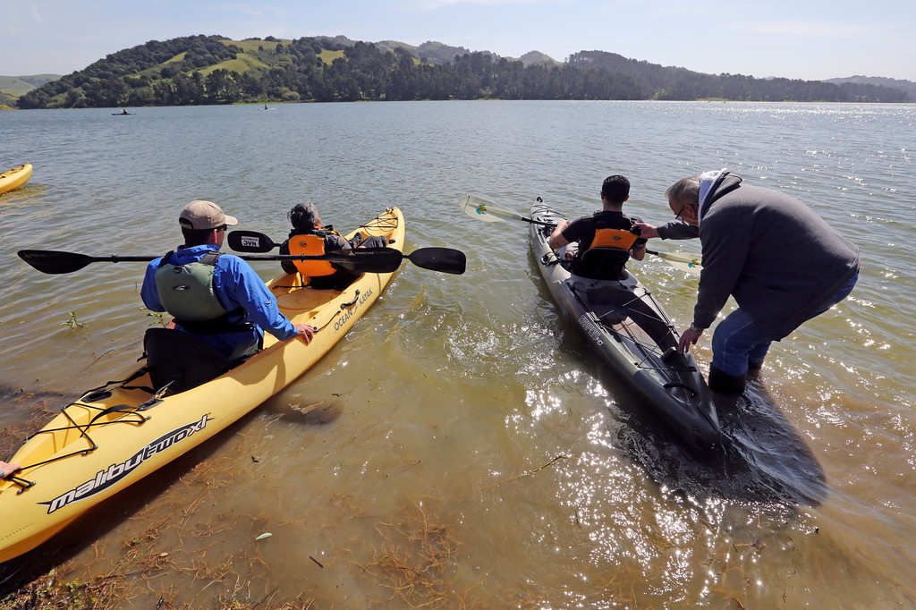 ". Rob Knoles, on of the four coordinators of the ""Heros on the Water\"" event, left, paddles out with veteran Albert Anub  as Paul Oulton, a volunteer from the NorCal Kayak Anglers club, helps another veteran get out on the water at the San Pablo Dam Reservoir Recreation Area on Friday, April 29, 2016.   (Laura A. Oda/Bay Area News Group)"
