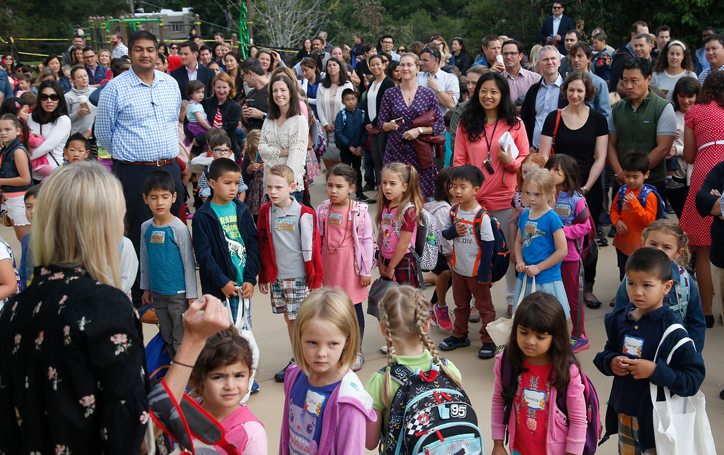 . After being shuttered for many years, Hoover Elementary students line up to hear principal Lisa Booth welcome  them to the first day of school in Burlingame, Calif., Wednesday morning, Aug. 24, 2016. (Karl Mondon/Bay Area News Group)