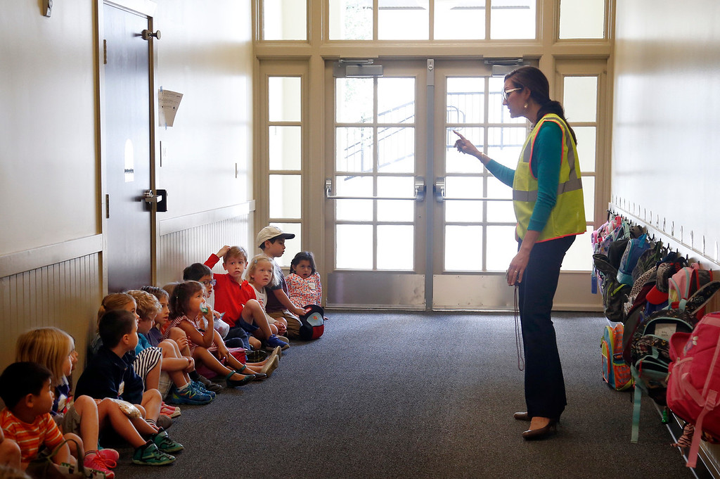 . Kindergarten teacher Laura Afshar meets her students on the first day of school at Hoover Elementary in Burlingame, Calif., Wednesday morning, Aug. 24, 2016. The school reopened today after being shuttered for many years. (Karl Mondon/Bay Area News Group)