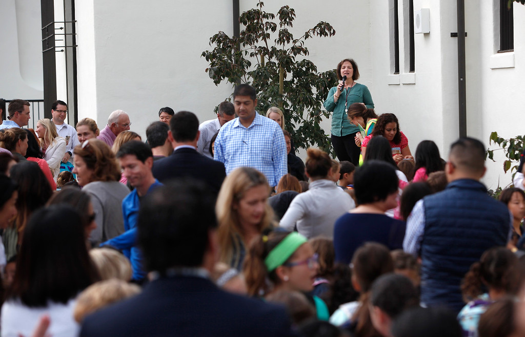 . After being shuttered for many years, Hoover Elementary principal Lisa Booth welcomes students and parents to the first day of school in Burlingame, Calif., Wednesday morning, Aug. 24, 2016. (Karl Mondon/Bay Area News Group)